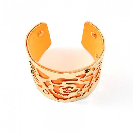 Bracelet manchette dorée et fuschia
