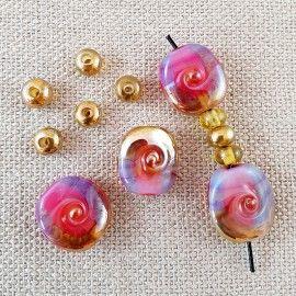Perles de verre rose et doré style Murano